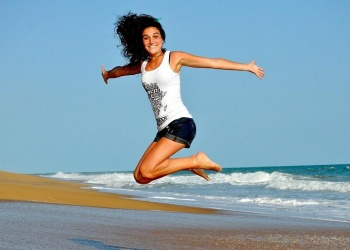Woman jumping at the beach