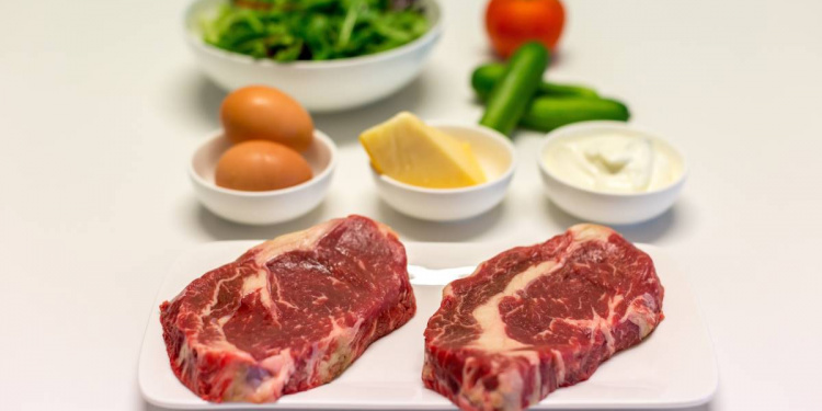 Raw steaks and eggs